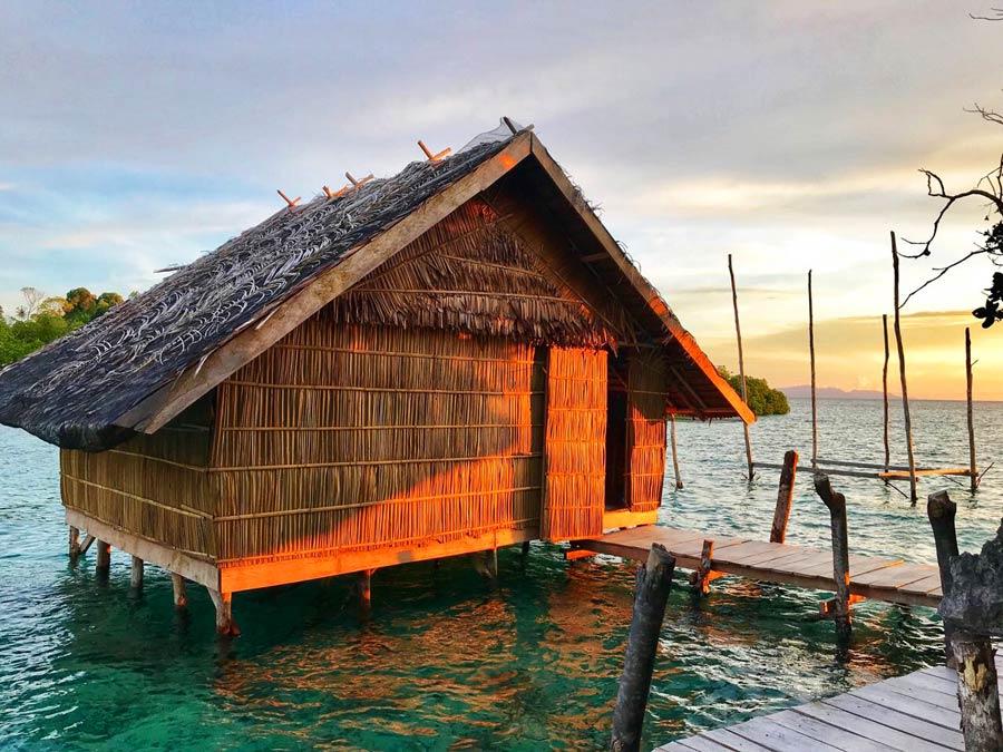 Raja Ampat homestay Beser bay overwater bungalow gam island sunset