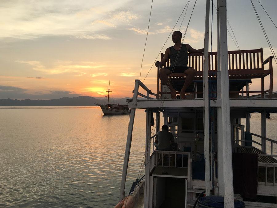 Liveaboard boat Komodo National Park top deck sunset captain